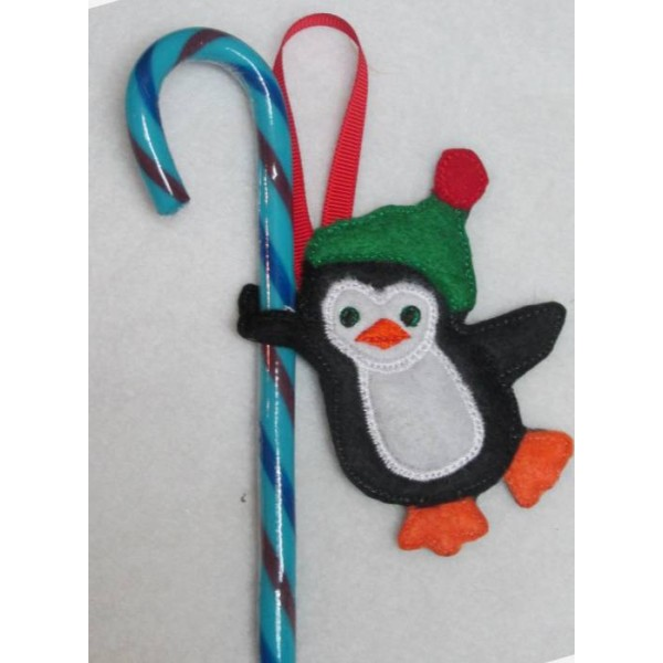 ... in the hoop penguin candy cane holder give your candy canes some